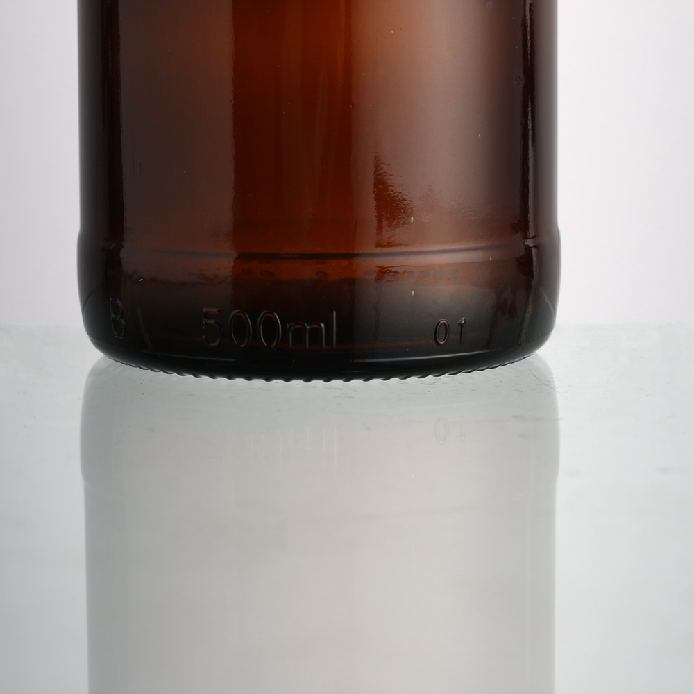 Customized cheap price shape brown amber beer glass bottle in 500 ml with crown
