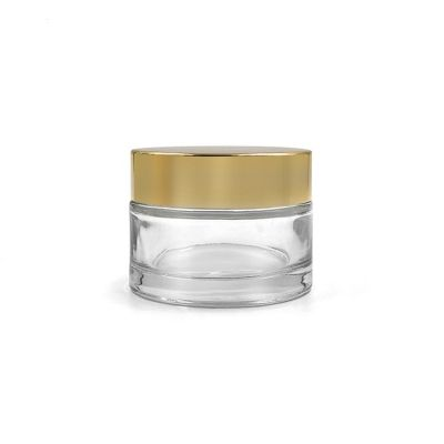 Big size empty cosmetic packing custom 180g clear glass cosmetic jar with uv gold plastic lid