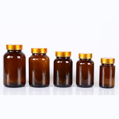 10oz round wide mouth amber medicine glass bottle with lined black plastic cap